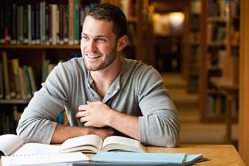 Smiling male student working